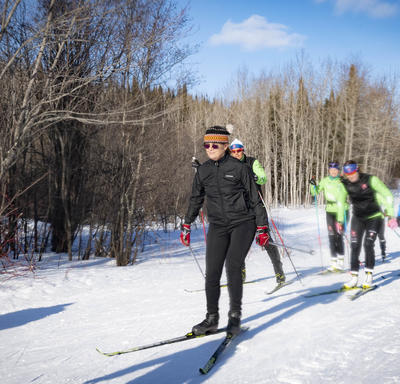 The Governor General cross country skis with competitive racers and youth.