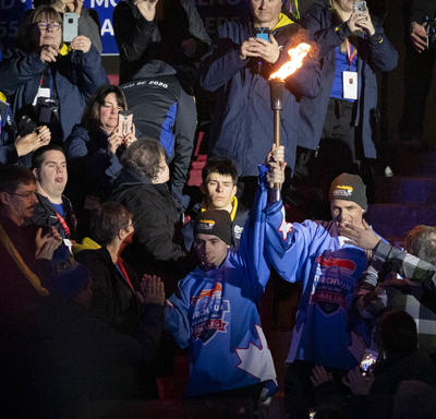 Athletes carry in the torch during the Special Olympics Canada Winter Games Thunder Bay 2020 Opening Ceremony.