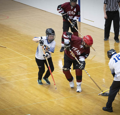 Special Olympics Athletes on court during a fast-paced play of floor hockey.