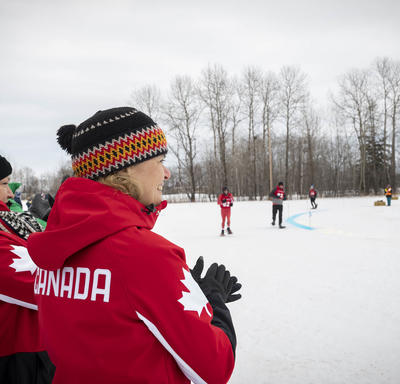 The Governor General cheers on Snowshoeing athletes during a race.