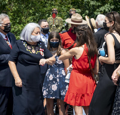 Governor General Mary May Simon greeting family and friends outside Rideau Hall.
