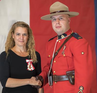 Constable Garrett Dove received a Sovereign's medal for volunteers.  He has gone above and beyond in mentoring and guiding First Nations youth in the communities of Pelican Narrows and Battleford.