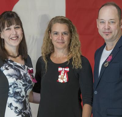 Dr. Angela Irvine and Cole Marshall received Medals of Bravery.  They rescued Dr. Irvine's young sons who were in danger of drowning in the South Saskatchewan River, in Medicine Hat, Alberta.