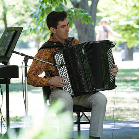 Ladom Ensemble's accordionist performs on the grounds of Rideau Hall for Chamberfest.