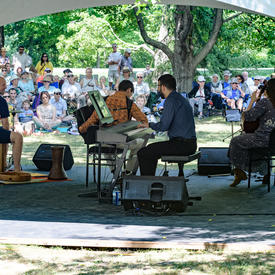 The Ladom Ensemble quartet performs on the grounds of Rideau Hall, under a tent, for Chamberfest.