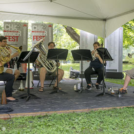 A quintet of brass musicians performs at Chamberfest 2018 on the grounds of Rideau Hall.
