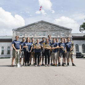 A group photo of the musicians who performed at Chamberfest 2018, standing in front of Rideau Hall.