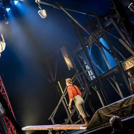 Two people perform acrobatics.