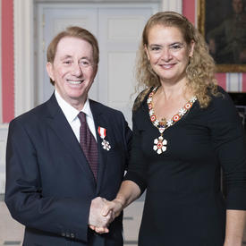 The Governor General, Julie Payette, stands next to Mark Breslin.  Both are wearing their Order of Canada insignias.