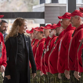 The Governor General, Julie Payette, inspects a row of Canadian Rangers.