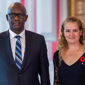 His Excellency Prosper Higiro, High commissioner of the Republic of Rwanda, stands beside the Governor General.