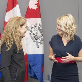 The Governor General is talking to Her Worship Tara Veer, Mayor of Red Deer.