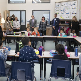 The Governor General visits a classroom during their lunch break.