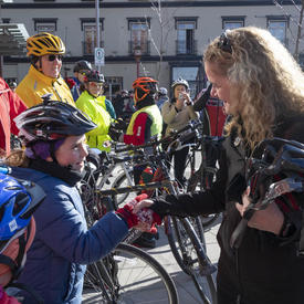 The Governor General shook hands with a cyclist.