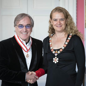Daniel Lamarre shakes hands with the Governor General