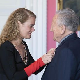 Eli Bornstein accepts his medal from the Governor General