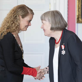 Kathleen Pearson shakes hands with the Governor General