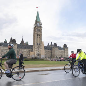 Cyclists depart from Parliament Hill by bike