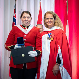 The Governor General gives the Governor General's Academic Medal to a winning student.