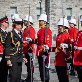 The Governor General is inspecting the parade.