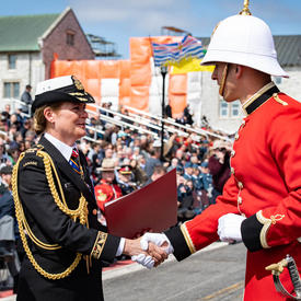 The Governor General hands commissioning scrolls to a member of RMC.
