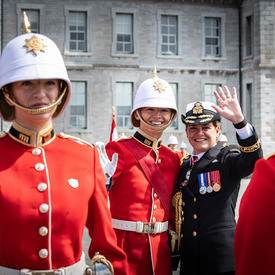 The Governor General and a member of RMC waved to the public.