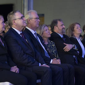 The Governor General sits among attendees at the unveiling of stamps celebrating Apollo 11 event.