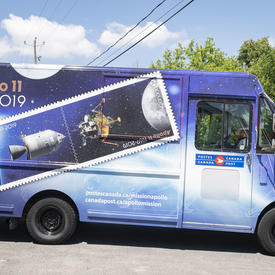 A photo of a Canada Post truck painted with the Apollo 11 design.