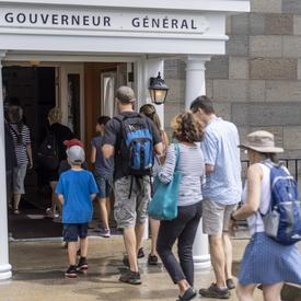 Visitors enter the Governor General's residence.