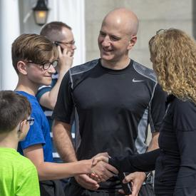 A family is meeting the Governor General.