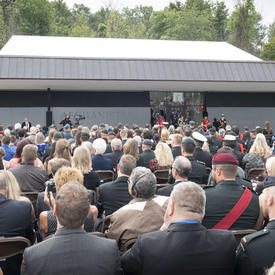 A photo of the roughly 1,200 guests in attendance from behind, as the Governor General delivers remarks.
