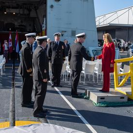 The Governor General is greeted by members of the Canadian Navy as she boards the HMCS St John's.