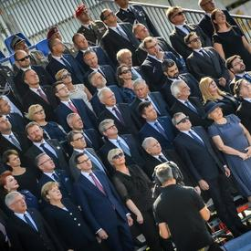 A photo of the Heads of State, standing at the commemorative ceremony.