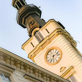 A photo of a clock tower in Warsaw, Poland.
