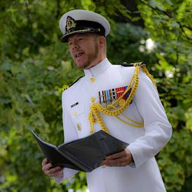 A Canadian Officer reads a citation during a Presentation of Canadian Honours Ceremony.