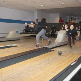 Members of the community bowling.