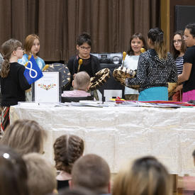 Students performed in a drumming circle.
