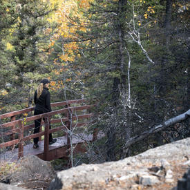 The Governor General walking on a path at Baker's Narrows.