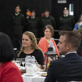 The Governor General sitting at a table with guests.