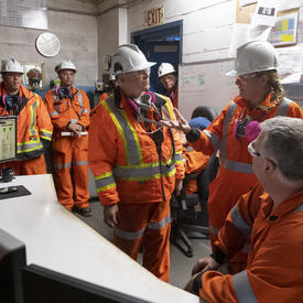 Governor General talking to Hudbay employees.