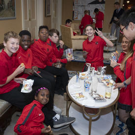 A photo of students tasting their 'space' snacks following the question and answer session with the Governor General.