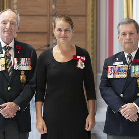 The Governor General stands for a photo alongside The Royal Canadian Legion executives, after receiving the symbolic first poppy.