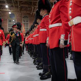 The Governor General inspects the Governor General's Foot Guards during a ceremony.