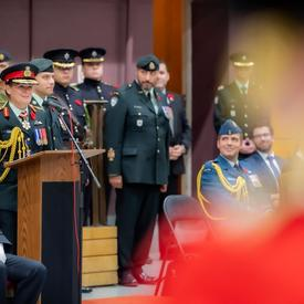 The Governor General delivers a speech at a podium during a Governor General's Foot Guards change of command ceremony.