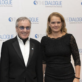 Daniel Lamarre, President and CEO of Cirque du Soleil, and Governor General of Canada Julie Payette is standing in front of a banner with multiple The Dialogue Leadership to the Americas logo.