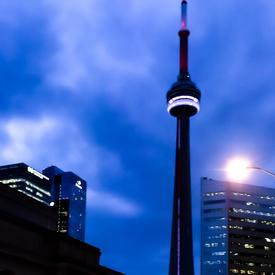 A photo of the CN Tower in Toronto, taken at night.