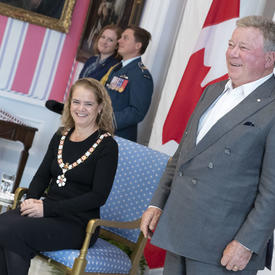 The Governor General looks on as William Shatner is invested into the Order of Canada.