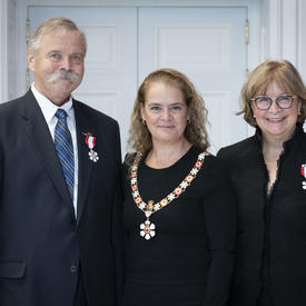 The Governor General takes a photo with newly invested members of the Order of Canada.