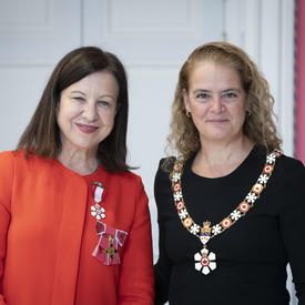 The Governor General takes a photo with Lyse Doucet at an Order of Canada ceremony.