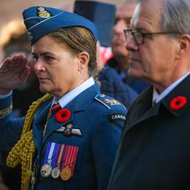 The Governor General salutes.